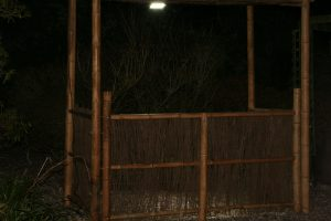 Thatched Bamboo Tiki Bars at night with in built lighting