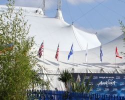 Cirque du Soleil hire bamboos and palm trees to dress the entrance of their main marquee