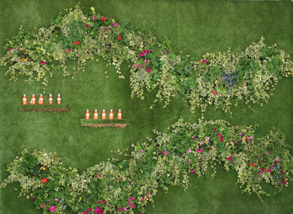 Artificial grass mixed with live plants created a living wall for L'Oreal